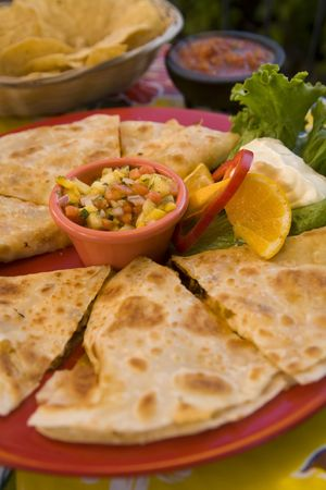 A favorite Mexican snack dressed up with chicken and mango salsa.