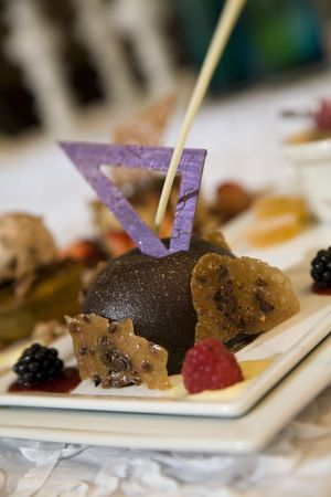 Chocolate pudding with sugarcraft and fresh berries
