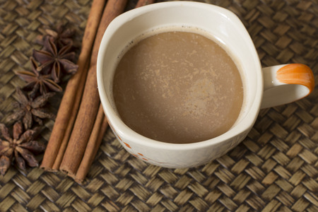 Cup coffee and Spices on woven bamboo background