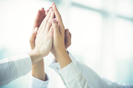 Foto de The four hands greeting with a high five - Imagen libre de derechos