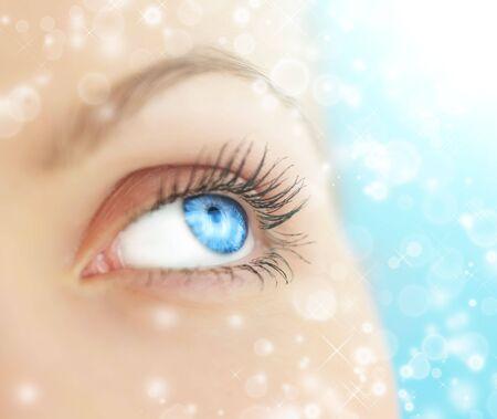 Human eye on blue background