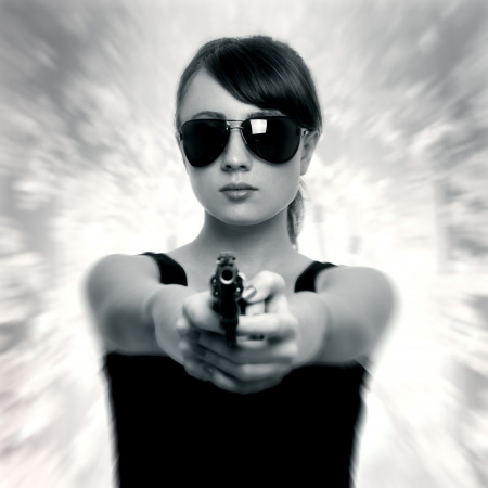 Young woman with gun. retro style