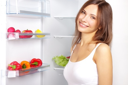 Picking food from fridge. Vegetables in the refrigerator