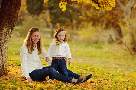 Photo for mother and baby girl in fall park - Royalty Free Image