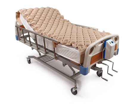 Foto de clean hospital bed with air mattress - clipping path - Imagen libre de derechos