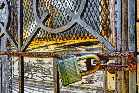 Photo pour Rusty, old, locked padlock on a latch  horizontally - image libre de droit