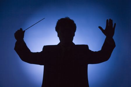 silhouette of conductor on blue background