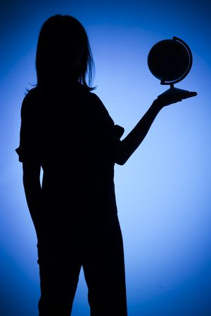 isolated on blue silhouette of woman with globe
