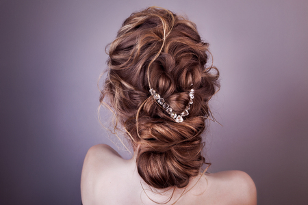 Photo for Model blonde Woman with perfect hairstyle and creative hair-dress, back view. - Royalty Free Image