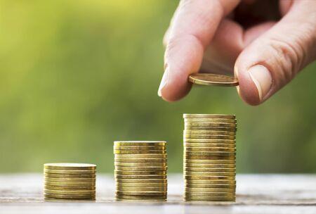 Photo pour Hand and money coins - financial freedom concept, background with copy space - image libre de droit