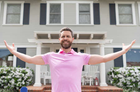 Photo pour happy bearded man owner near new house after rent or buy new home, ownership - image libre de droit