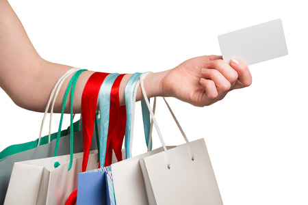 Photo pour woman hand with many bags and credit card on a white background - image libre de droit