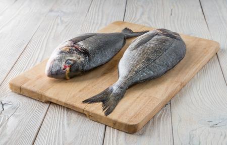 Photo pour fish on a wooden background - image libre de droit