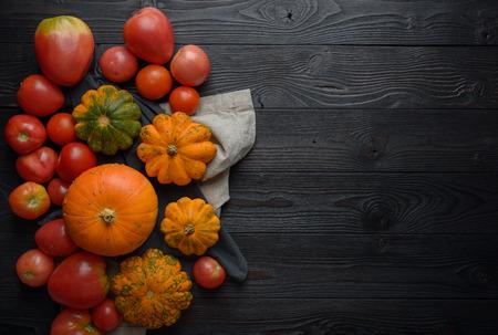 Foto für Composition of pumpkins and tomato on a wooden background - Lizenzfreies Bild