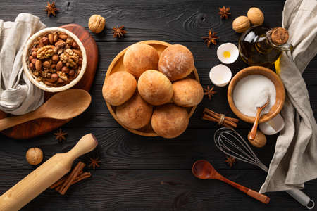 Photo pour cooked fresh buns for breakfast on wooden background among the ingredients, flat lay - image libre de droit