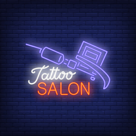 Tattoo salon neon text with tattoo machine icon.