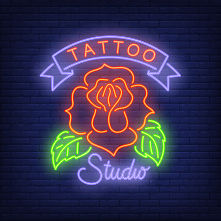 Tattoo studio neon sign with rose.