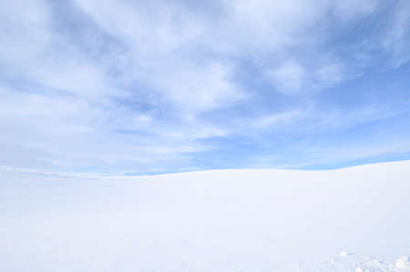 Snow Covers the Countryside Under a Partly Cloudy Sky on a Cold Winter Day on the Palouse of Washington State.