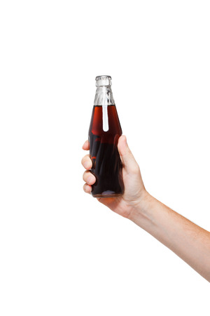 hand holding a bottle of cola on white backgroundの写真素材