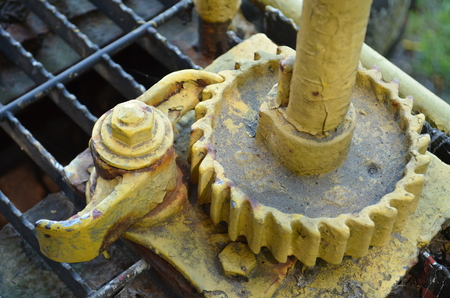 Rusty yellow gear on old train caboose
