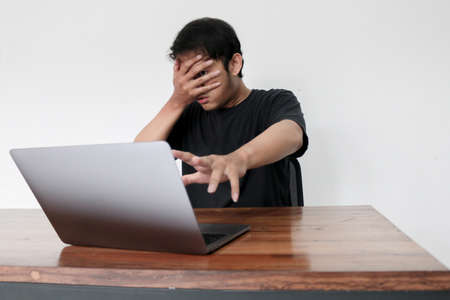 Photo pour Young asian man hiding his face with hand . - image libre de droit