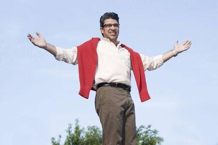 Photo pour Very happy man with arms outstretched  - image libre de droit