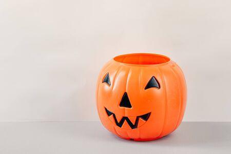 Foto de Happy Halloween Day, Spooky day. Pumpkin trick or treat basket, orange pumpkins, scary metal house - Imagen libre de derechos