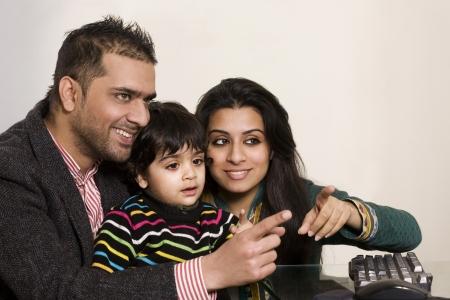 happy multi ethnic family of three enjoying together