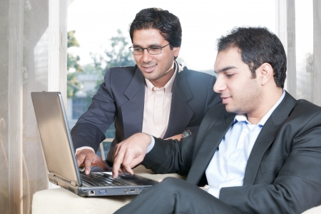 two Indian businessmen in meeting, two businessmen working on the laptop