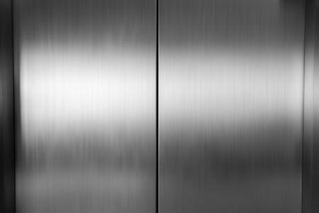 Photo pour Elevator door metal, stainless steel texture background - image libre de droit