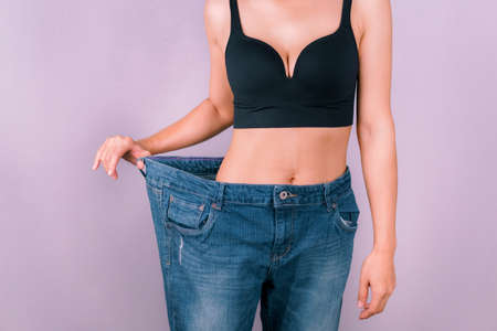 Photo for A young woman showing off a slim figure Exercise regularly, be healthy - Royalty Free Image