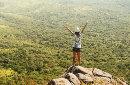 Photo pour Freedom hiker woman in nature on mountain with raised arms enjoying happiness in beautiful landscape - image libre de droit