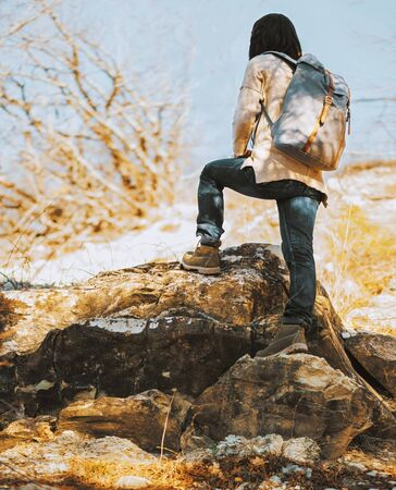Photo for Hiker woman with backpack go up on rock, rear view. Hiking and recreation theme - Royalty Free Image