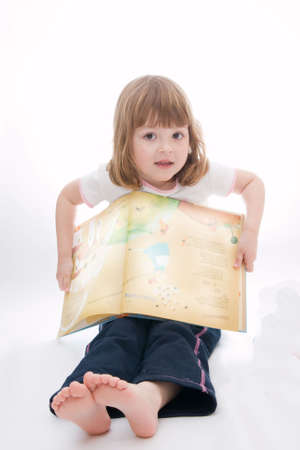 little girl reading fairy tales on white background