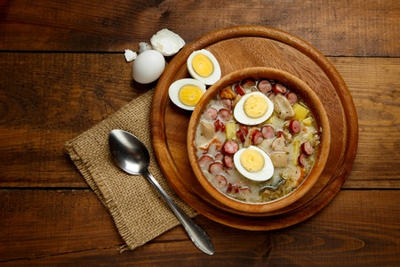Traditional Zurek with sausage and egg, white borscht, polish homemade Easter soup