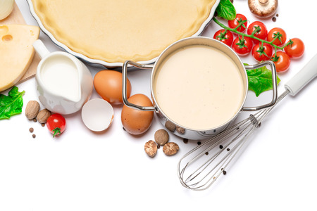Foto de shortbread dough for baking quiche tart in baking form and ingredients - Imagen libre de derechos