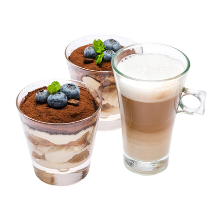 Photo for Classic tiramisu dessert with blueberries in a glass and cup of coffee isolated on a white background with clipping path - Royalty Free Image