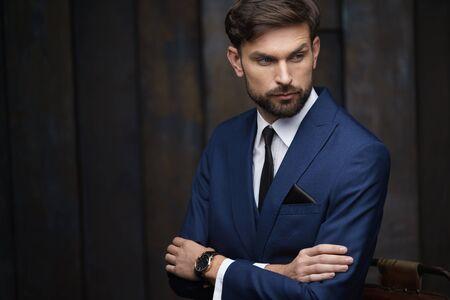 Photo pour indoor photo of young handsome stylish businessman wearing suit - image libre de droit