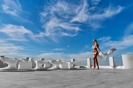 Foto de The young woman in white pareo on a terrace and blue sky on a background - Imagen libre de derechos