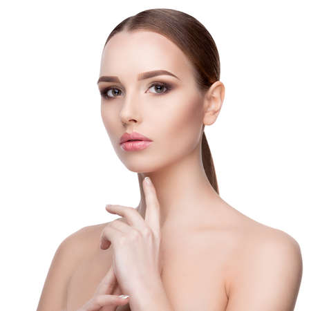 Photo pour Beauty Portrait of Young Woman with Perfect Clean Fresh Skin close up isolated on white background - Skin Care Concept.. - image libre de droit