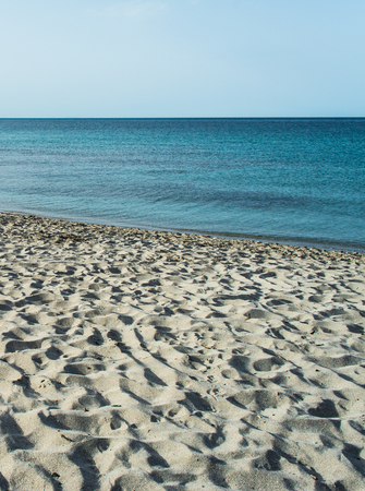 View of sardinian beach of Le Bombarde, near Alghero, in the early morning of summero