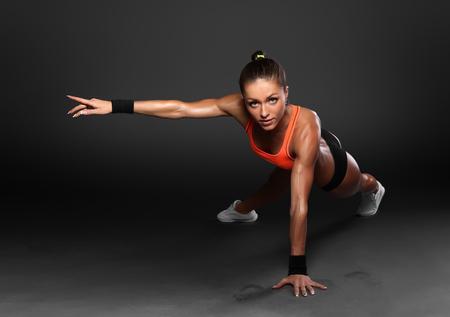 Photo pour Young Woman Doing Push-Ups workout fitness posture body building exercise exercising on studio - image libre de droit