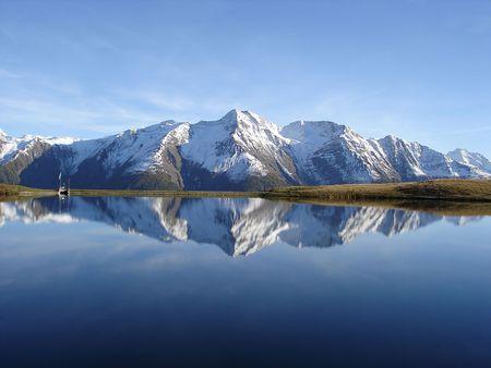 Foto de Reflection in the water of the quiet and beautiful Bettmersee Lake, Aletsch region, Valais, Switzerland.       - Imagen libre de derechos