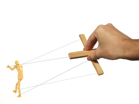 A 3d image of puppet and photograph of master hand.