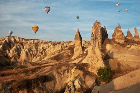 Morning balloon flight over the mountains in Cappadocia