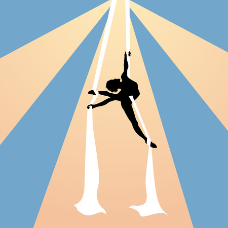 Air gymnast on silk ribbons under the dome of circus
