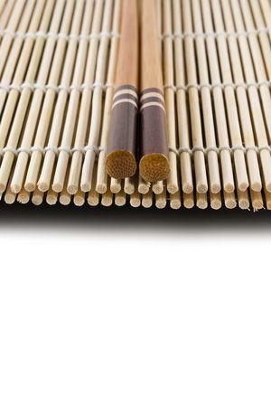 Chopsticks on a Japanese sushi rolling mat