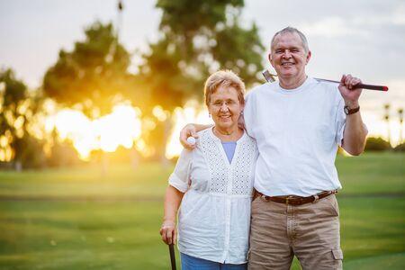 Foto de portrait of happy senior couple enjoying active lifestyle playing golf - Imagen libre de derechos