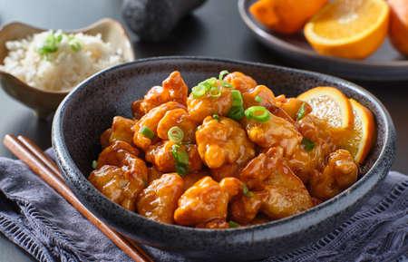 Photo pour bowl of chinese orange chicken on table top - image libre de droit
