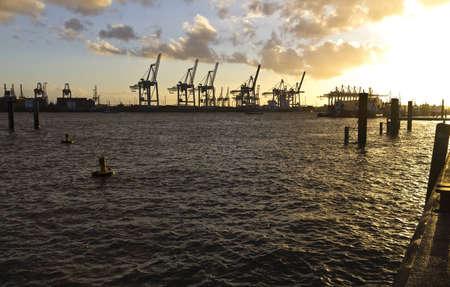 Cranes of Hamburg port, Elbe river in Germany.